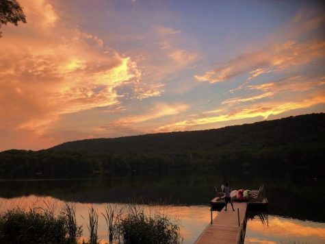 A beautiful summer sunset in the mountains overlooking a dock
