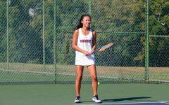 Nancy Mabrey 21 prepares to receive a serve during a match