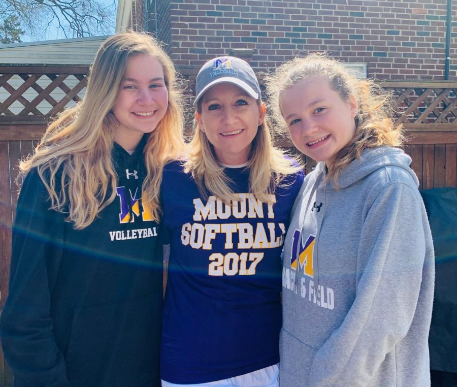 Mary Kate, Emily, and Mrs. Feilke pictured sporting their Mount gear in their backyard.