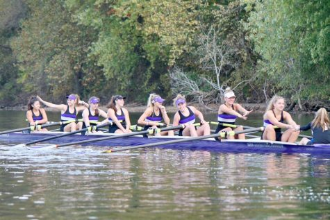 Rowers share a laugh in-between pieces at a fall practice
