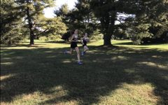 Two members of the Mount cross country team competing in a race.