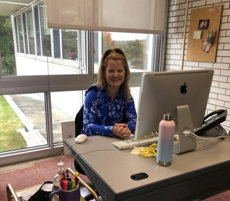 Ms. McGee sitting in her new office by the Alumnae Room