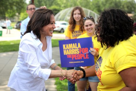 Vice presidential nominee Kamala Harris greets young supporters of her campaign.
