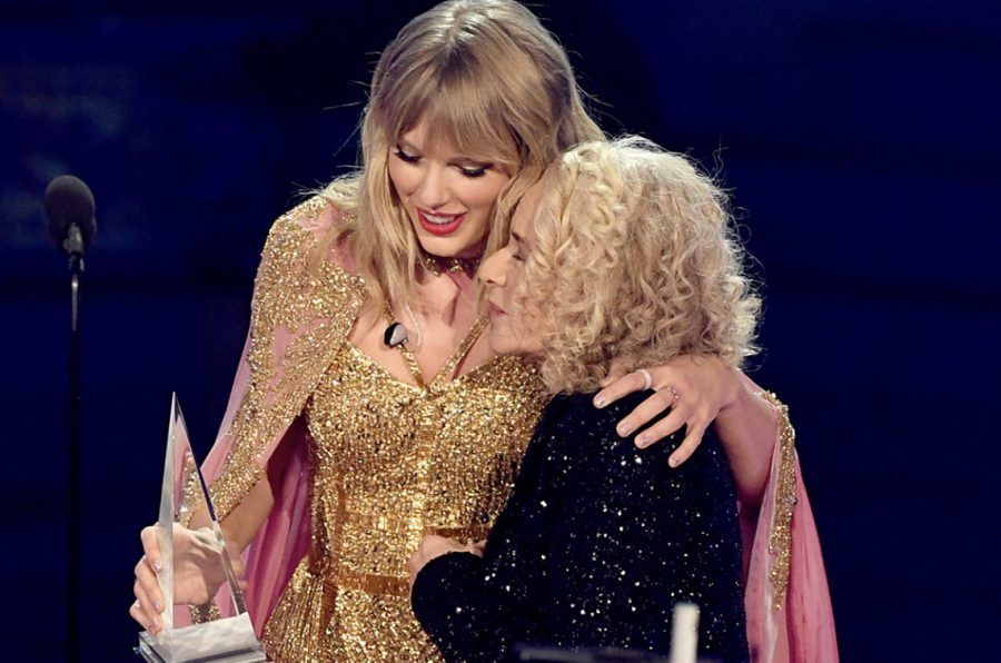Carole King and Taylor Swift after King presented Swift with the AMA Artist of the Decade at the 2019 AMA Awards